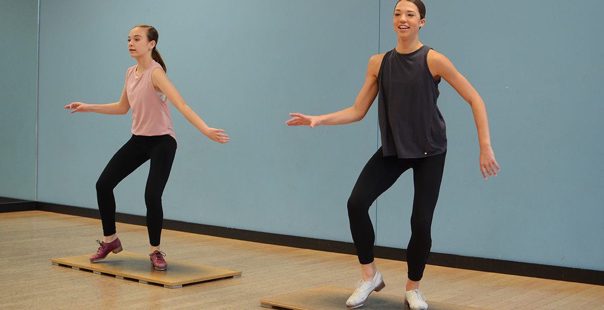 Teenage patients in dance studio.