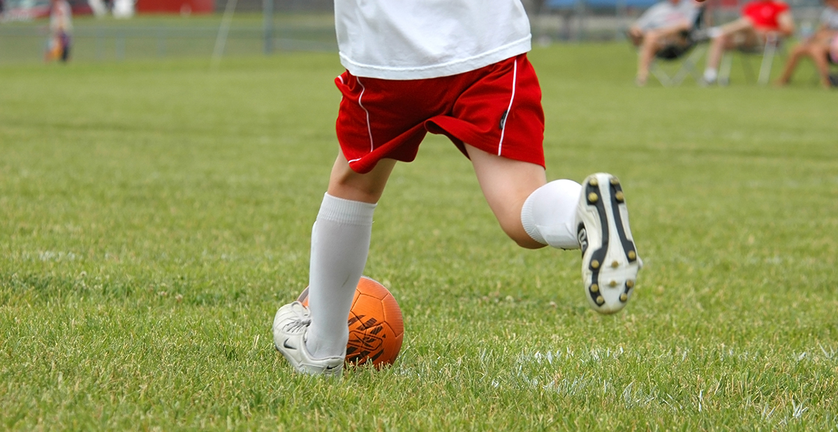 Boy playing soccer.