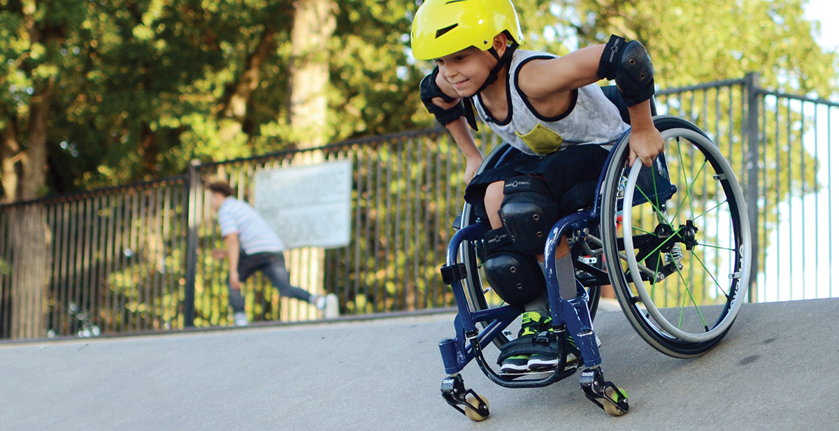 Patient in his wheelchair at a skate park.