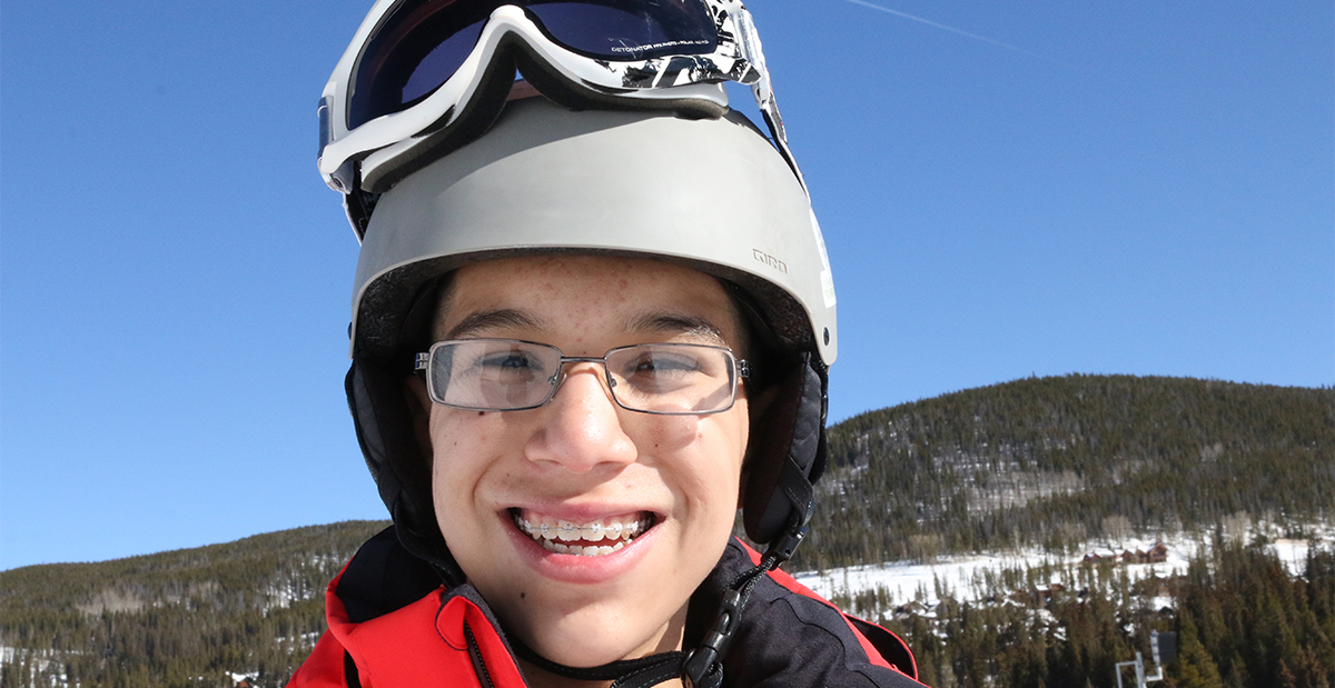 alfonso with helmet and goggles on while on 2017 ski trip