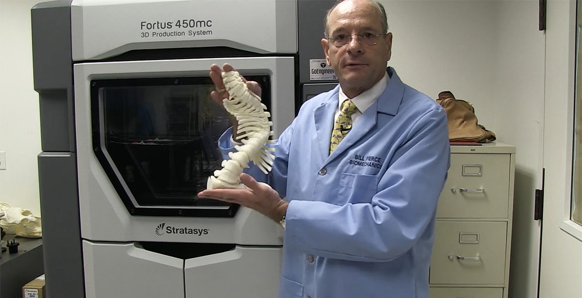Bill Pierce showing off a 3D model of a spine.