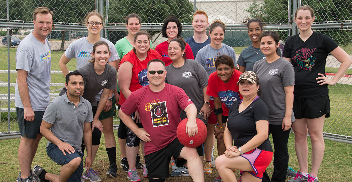 James and Sports Medicine staff members play kickball.