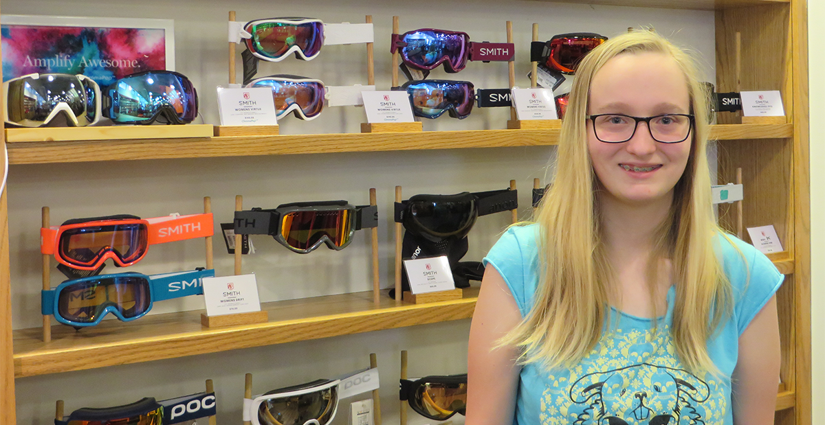 olivia in front of ski goggle wall at saint bernard