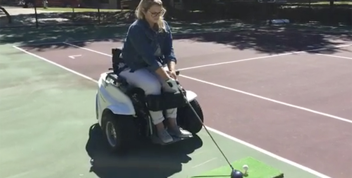 Recreational Therapist demonstrates using the Paragolfer.