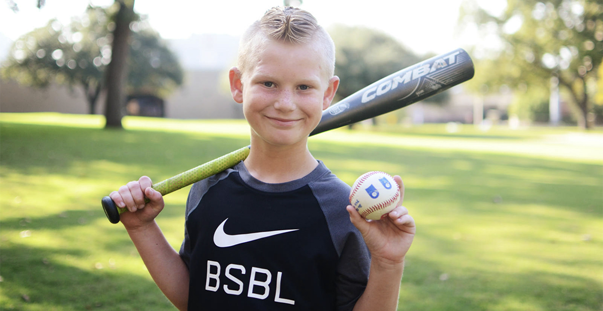 blonde haired boy with baseball bat and baseball