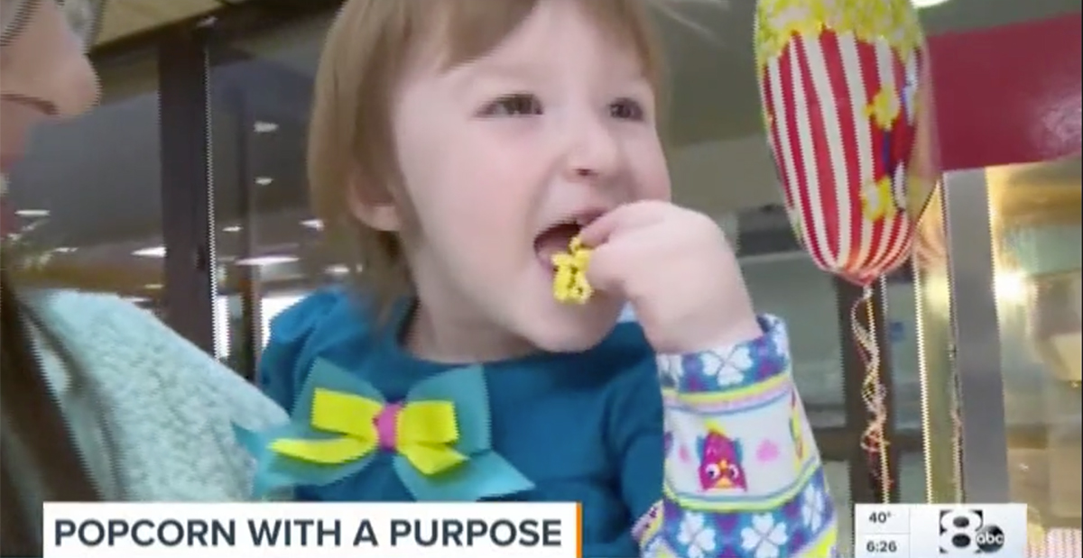 little girl eating popcorn on wfaa
