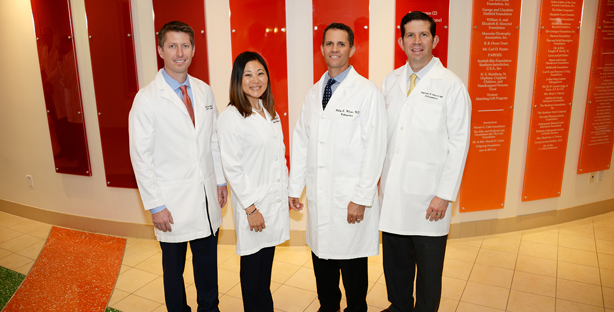 Sports Medicine doctors pose for a photo.