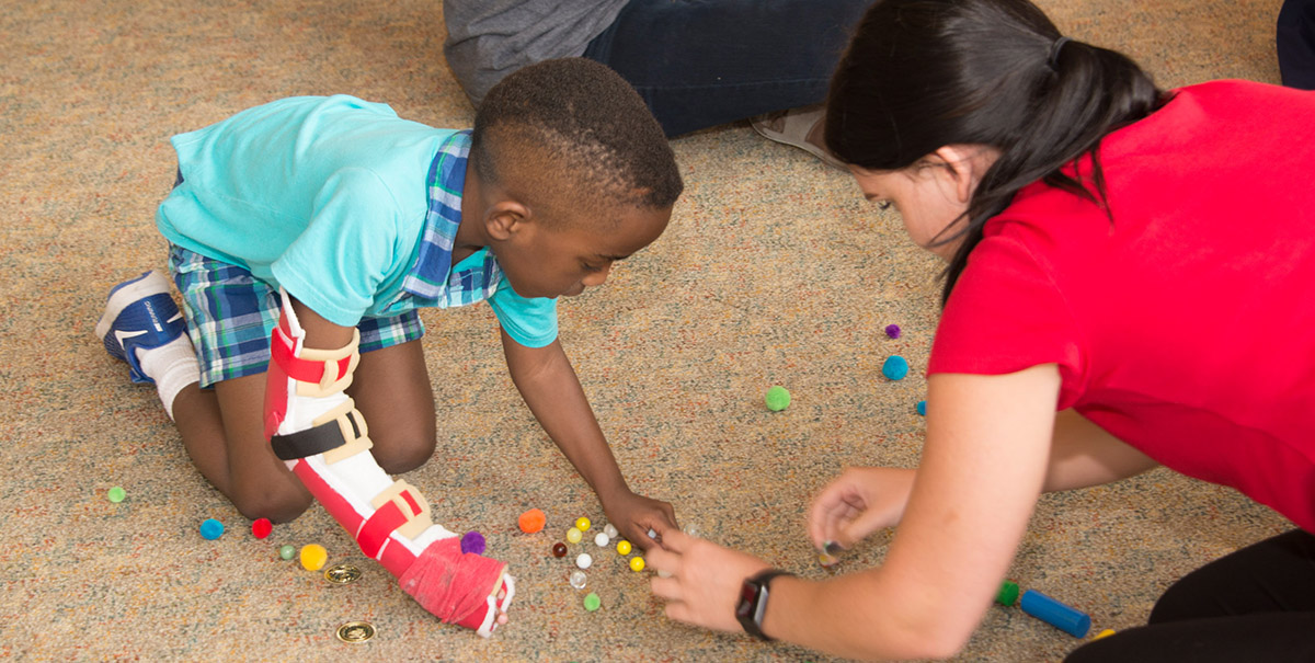 A child participating in the CIMT program.