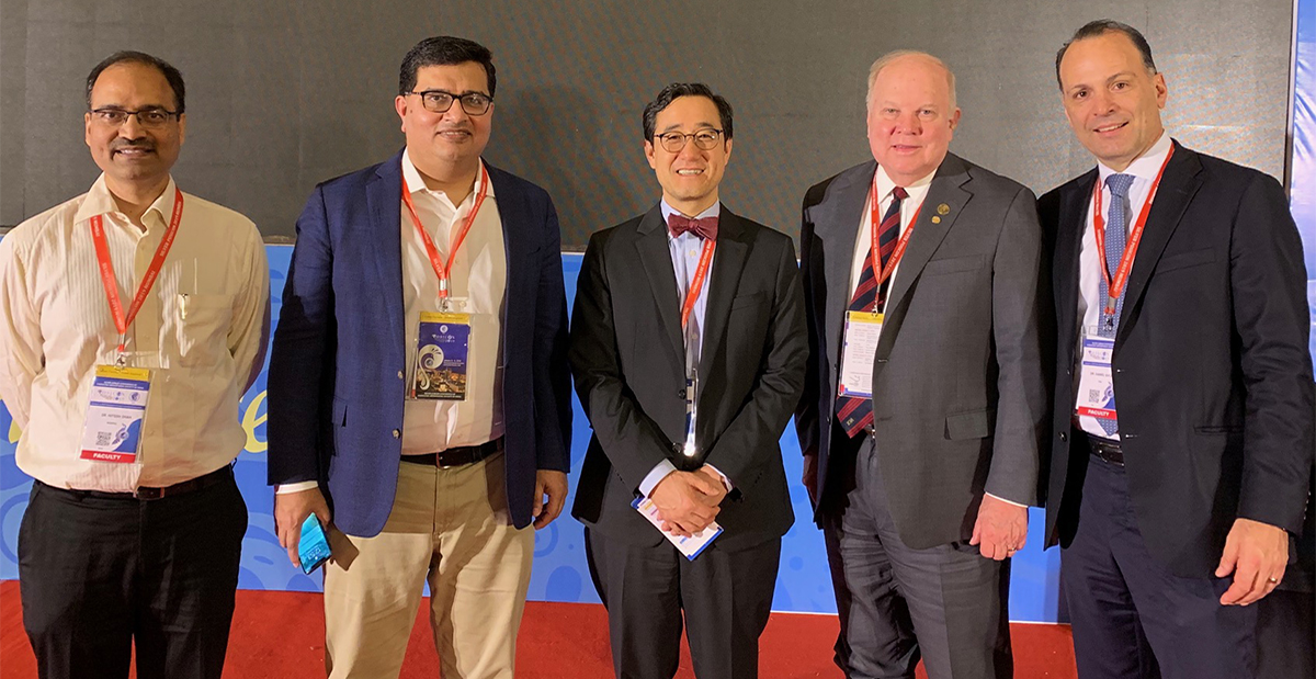 Drs. Kim and Sucato at POSI conference in India with other attendees.