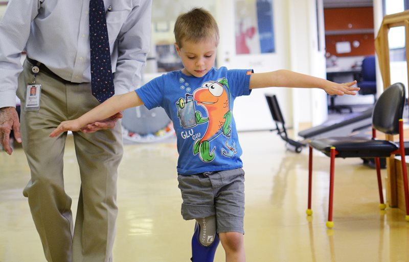 Doctor helps young boy with prosthetic leg walk at Texas Scottish Rite Hospital for Children
