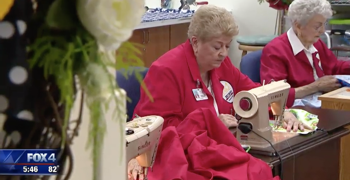 Volunteers sew bed sheets and gowns for patients