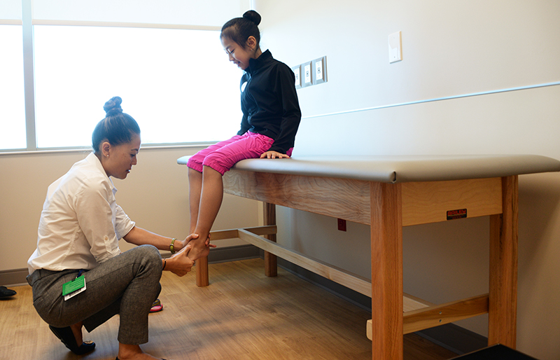Physician examining patient at Texas Scottish Rite Hospital for Children