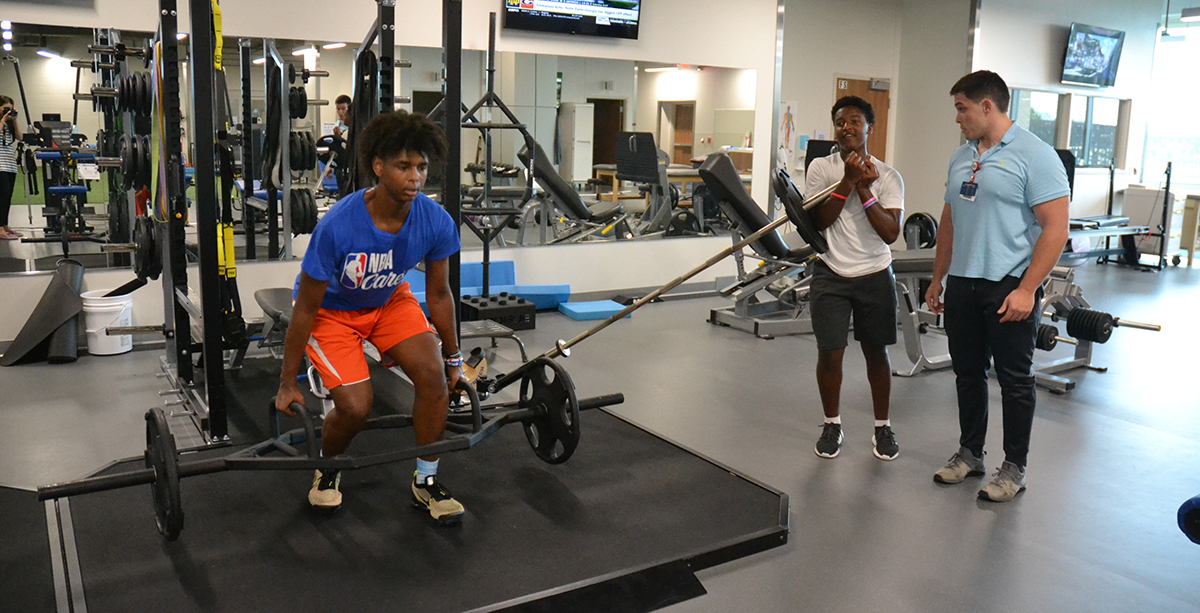 Ty Cox, patient, in the sports therapy gym