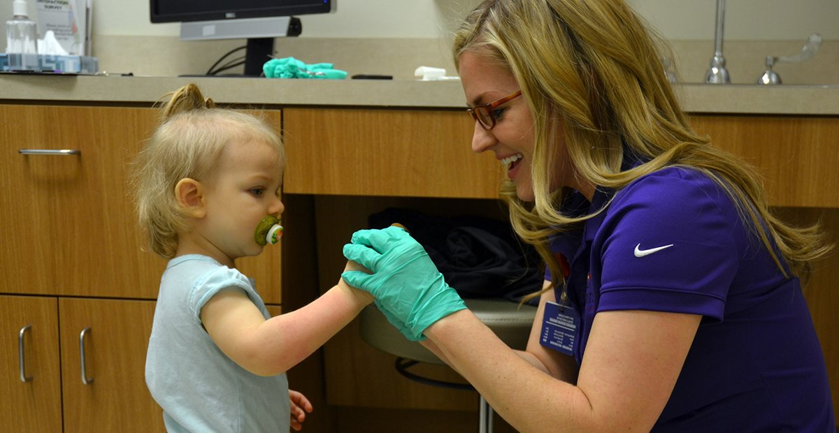 Baby patient working with Texas Scottish Rite Hospital for Children nurse
