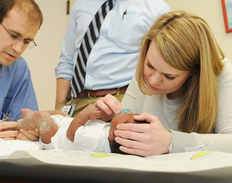 Child Life Specialist helping infant at Texas Scottish Rite Hospital for Children