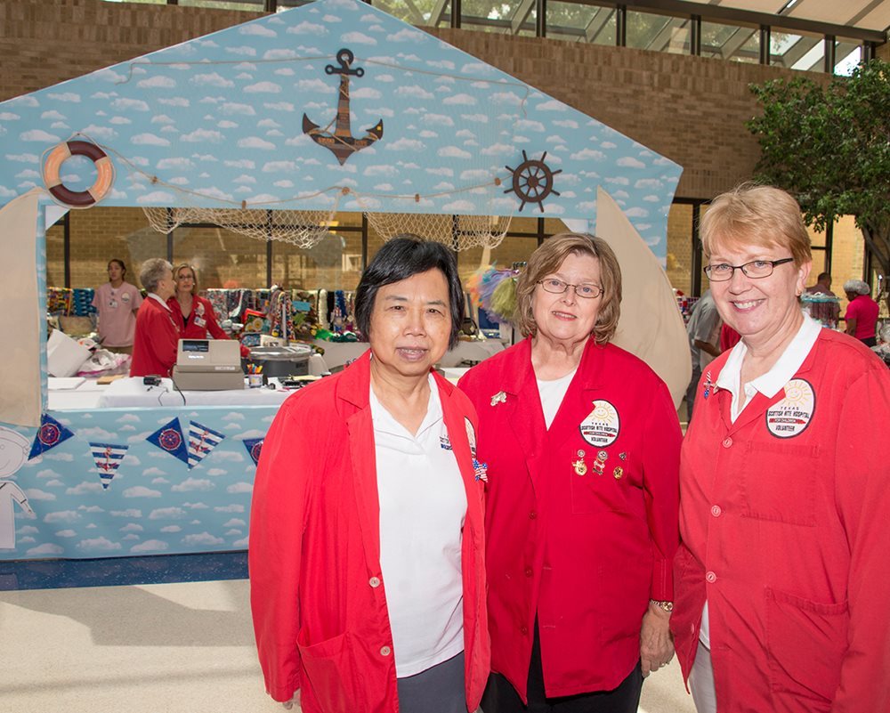 Members of adult volunteer program helping at Texas Scottish Rite Hospital for Children event