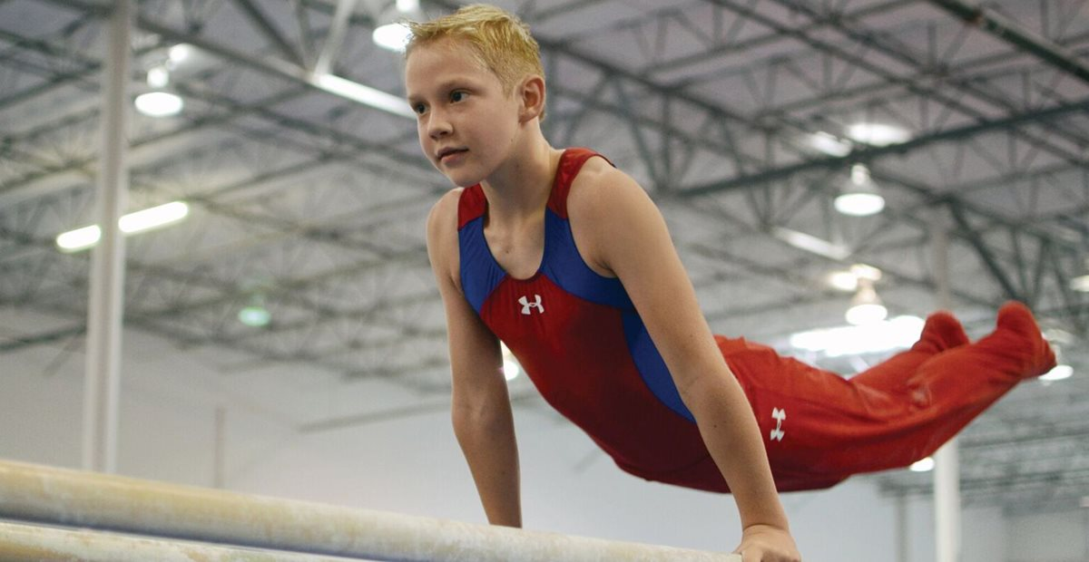 Cody on gymnastic bars