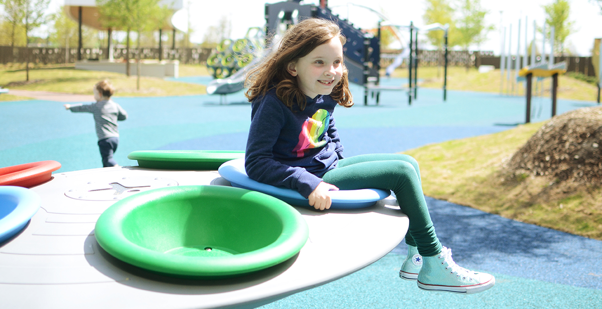 Young girl playing on the playground