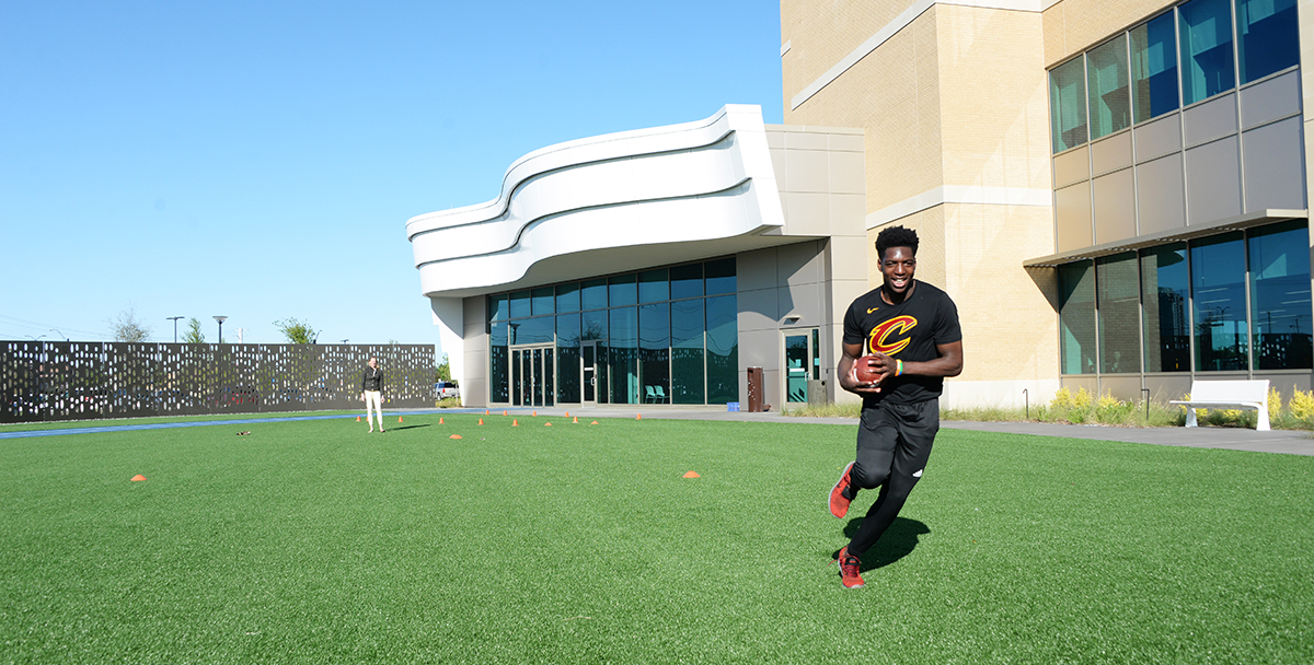 patient playing football at Frisco campus