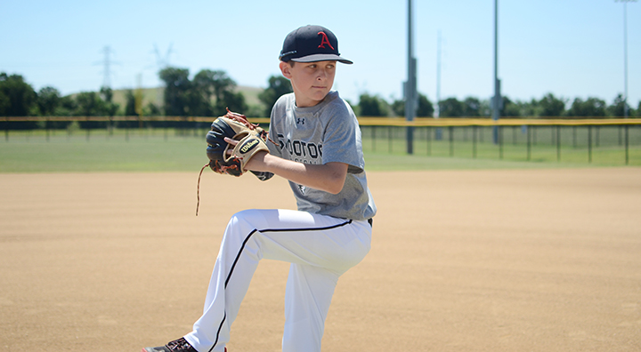 Baseball player, Jagger, throws a pitch