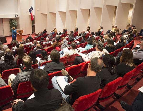Attendees to a conference in the auditorium