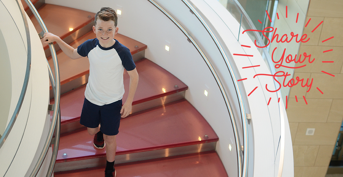 Aidan on the stairs at the Frisco campus