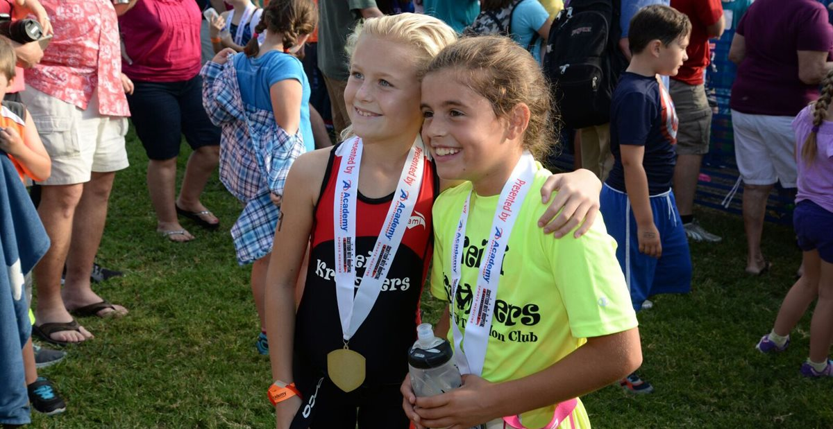 Children embracing after race