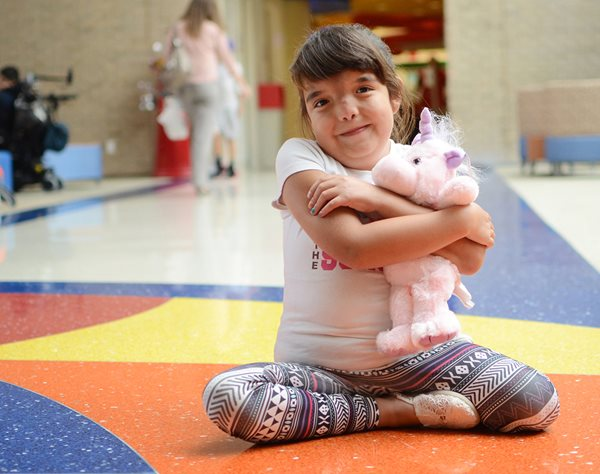 Young girl recovering from treatment for pediatric scoliosis of the spine at Texas Scottish Rite Hospital for Children
