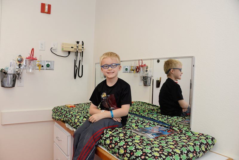 Pediatric developmental disability patient in exam room at Texas Scottish Rite Hospital for Children