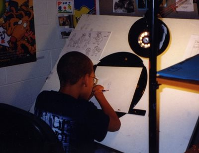 Desmond, age 11, visiting artist and animators at Nickelodeon Studios.