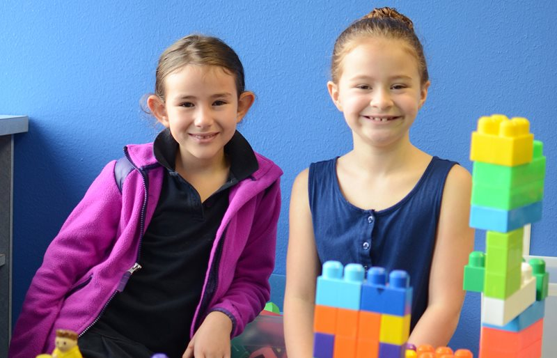 Texas Scottish Rite Hospital for Children patients smiling while playing with blocks