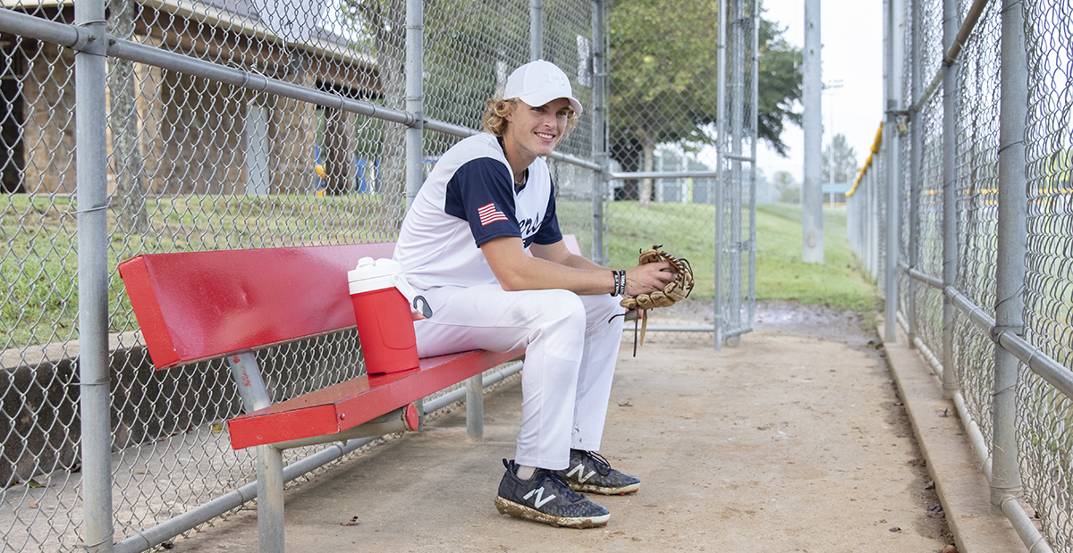 baseball player in the dugout