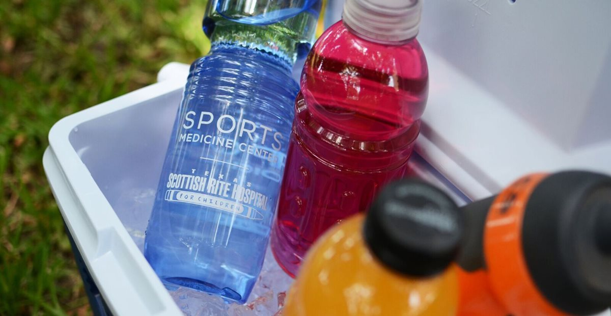 Texas Scottish Rite Hospital for Children water bottle next to sports drinks