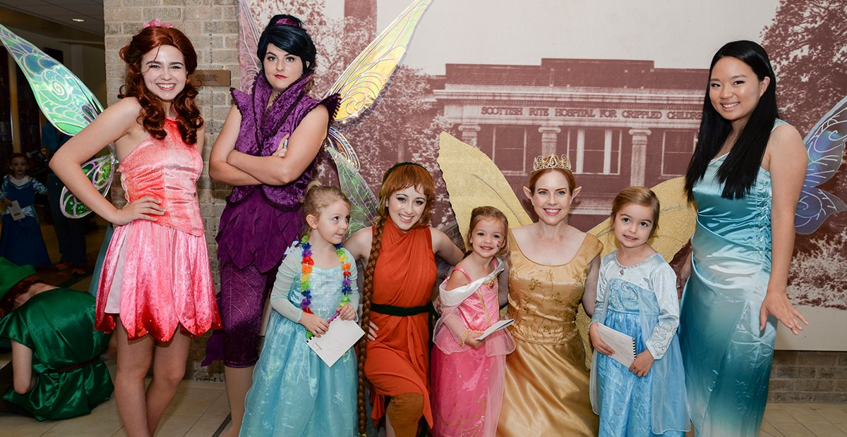 Patients at Texas Scottish Rite Hospital for Children pose with princesses
