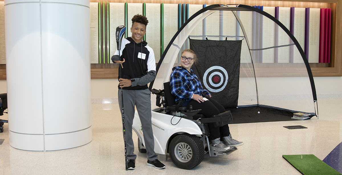 Patients, Korban and Jordan at an inclusive golfing event