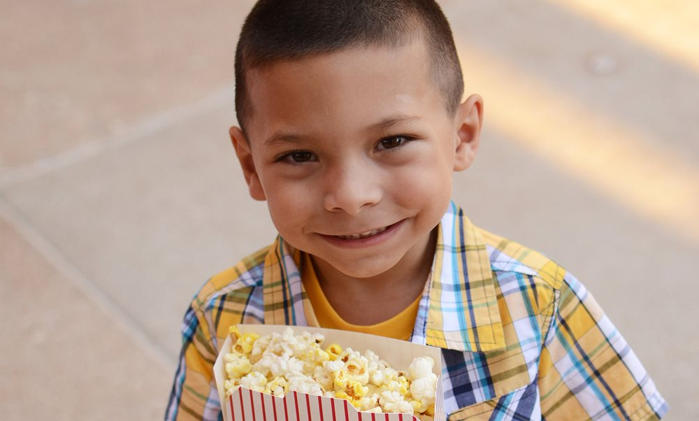 Texas Scottish Rite Hospital for Children orthopedic patient eating popcorn
