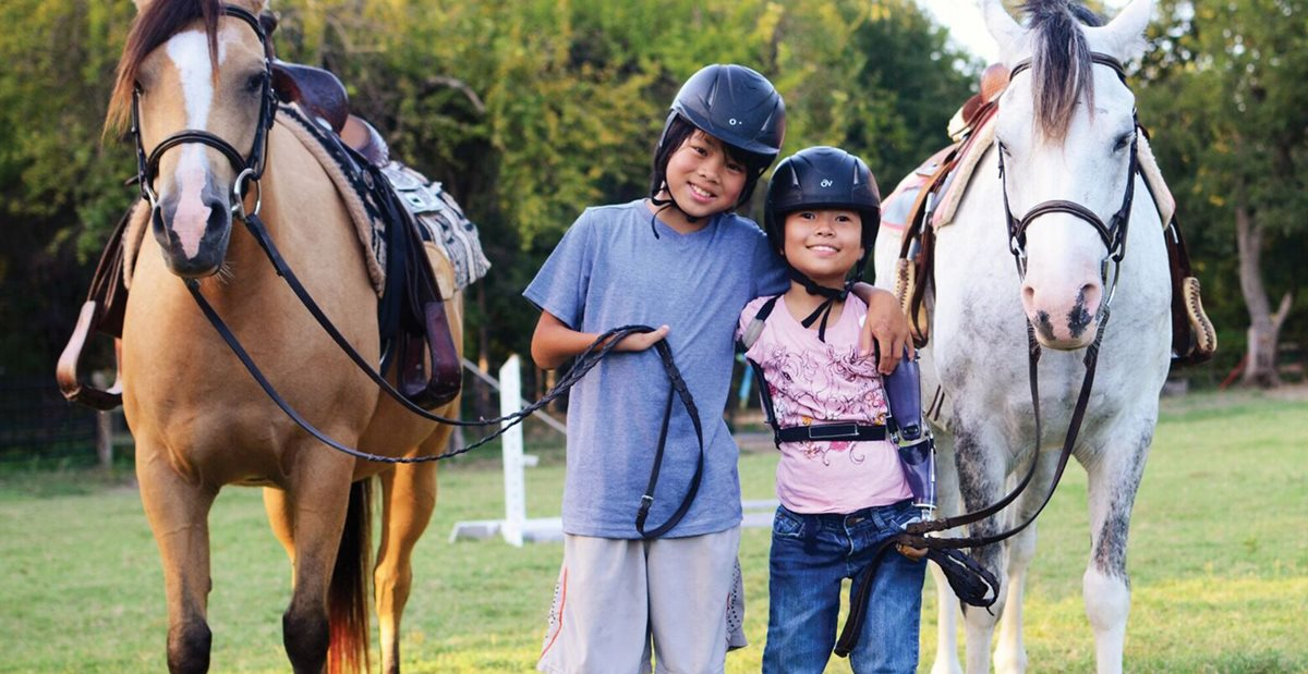 Patients from Texas Scottish Rite Hospital for Children go horseback riding