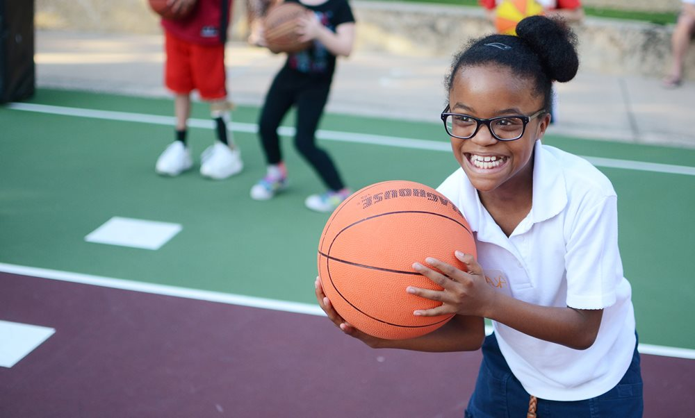 Pediatric patient playing basketball at Scottish Rite for Children