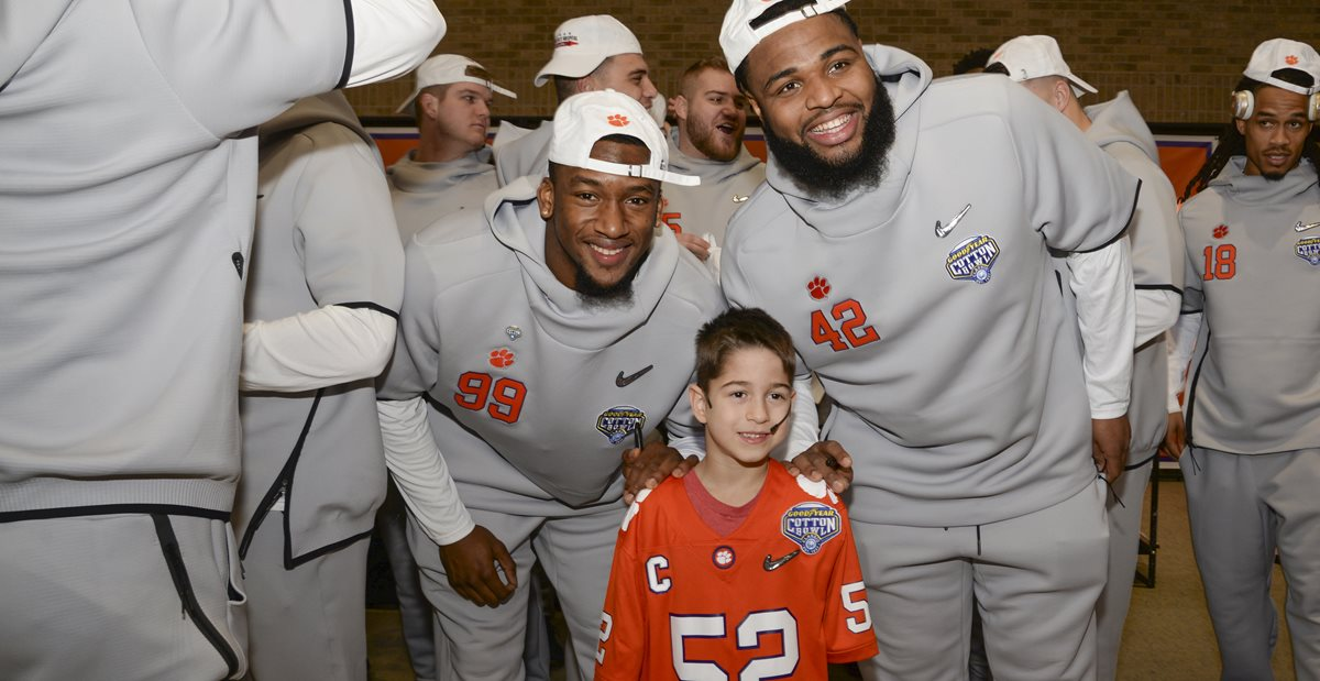 Layton Horner with Clemson football players