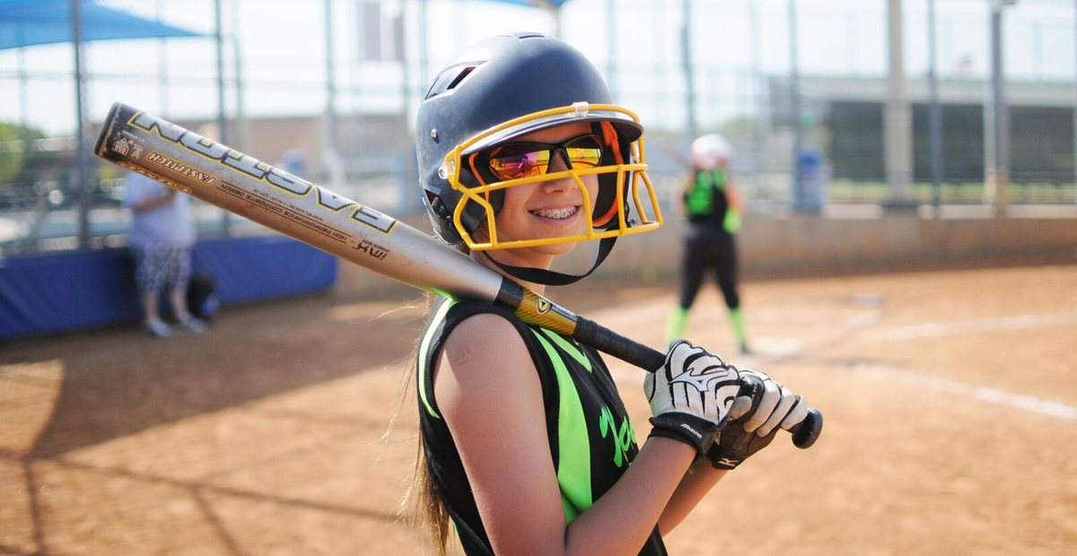 Teenage girl playing softball