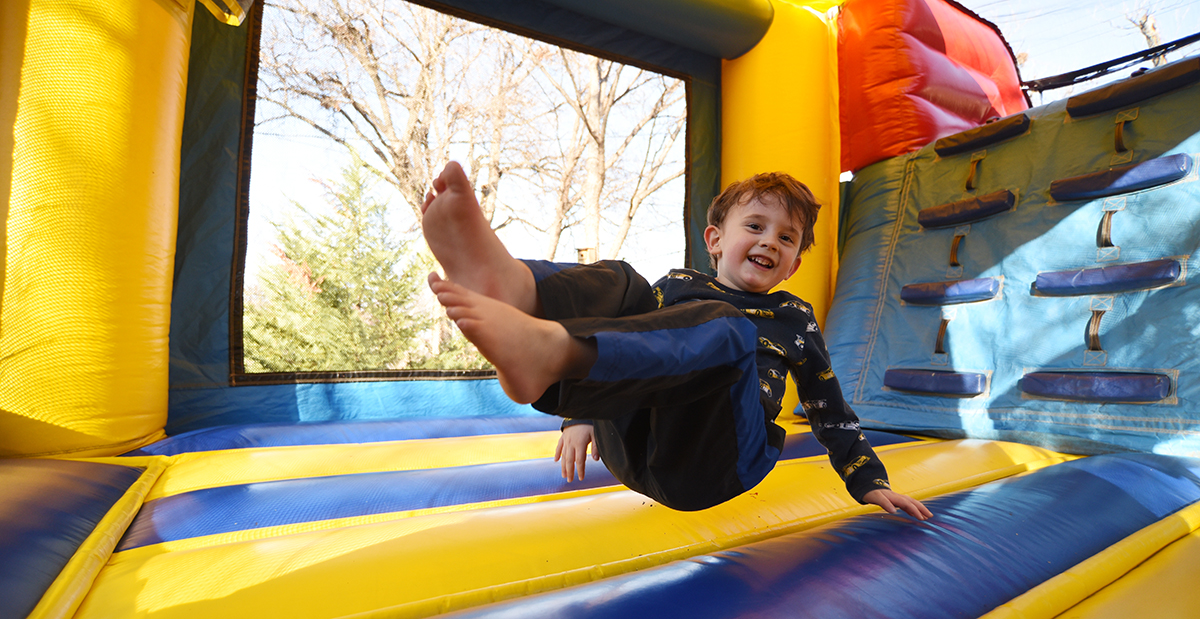 Patient jumping in a bounce house