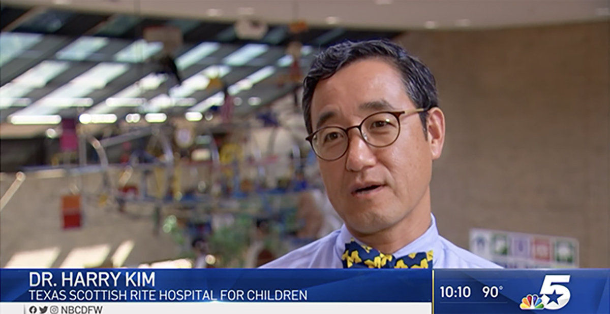Dr. Kim on hospital atrium bridge
