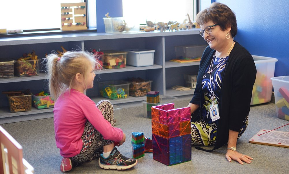 Child and doctor at Dyslexia Educator Center at Texas Scottish Rite Hospital for Children